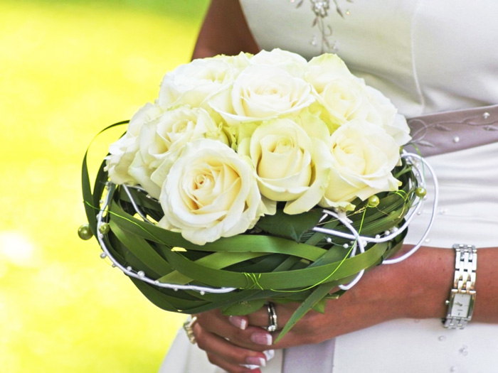 Woman holds perfect flowers for her wedding day