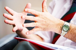 Hands demonstrating communicating and giving feedback between partners