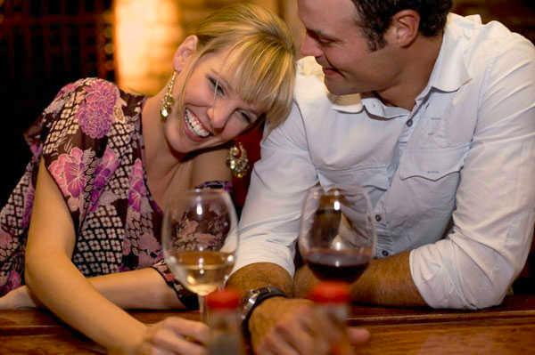 a man flirts with a woman at a bar