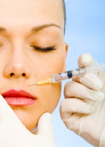 A woman gets botox injections