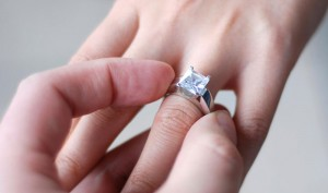 Man proposes to his girlfriend with a diamond ring
