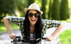 Girl wears 'ironic' hat riding a bike